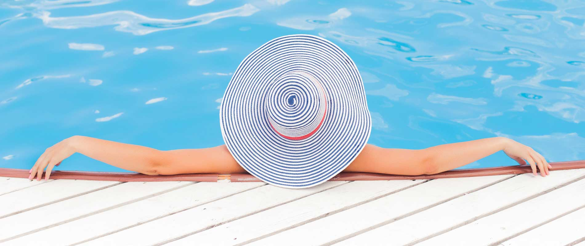 Woman Wearing a Hat in the Pool